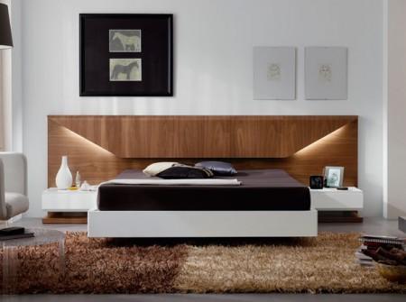 Dormitorio moderno de estilo sobrio y elegante en tonalidades cálidas acabado en nogal americano y laca blanco brillo.